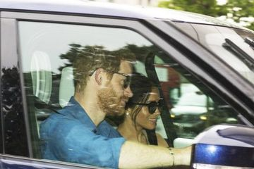 Prince Harry and Meghan Markle can't stop smiling as they arrive at Kensington Palace after wedding