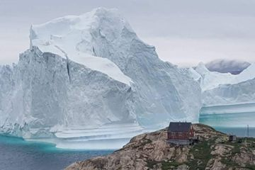 A Giant Iceberg Parked Offshore. It's Stunning, but Villagers Hit the Road.