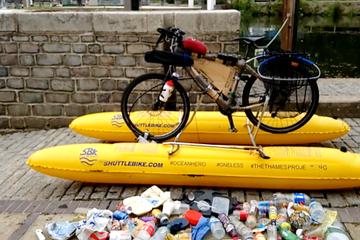 Man bikes on water to clean up plastics