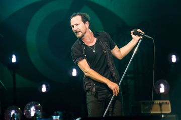 Pearl Jam poster shows bald eagle pecking at Trump corpse