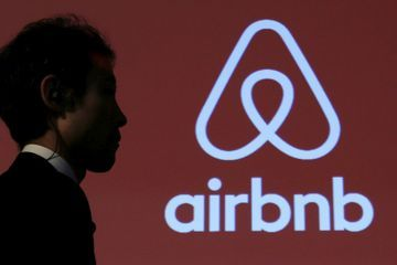 Airbnb Wants Hosts to Be Shareholders: DealBook's Closing Bell