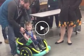 Minnesota High school robotics team builds an electric wheelchair for 2yr whose family couldn't afford one (Video)