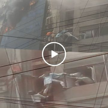 Brave citizens rescue trapped girl in deadly Bangladesh building fire (Video)