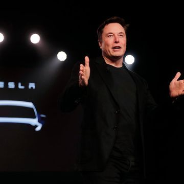 DealBook Briefing: Tesla Wants You to Focus on Its Robo-Taxis (not Its Finances)