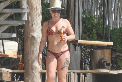 Pink Kicks Back and Relaxes With a Beer During a Romantic Beach Getaway With Carey Hart