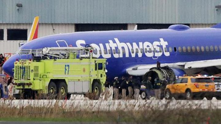 A Southwest Airlines jet sits on the runway at Philadelphia International Airport after it was forced to land with an engine failure, in Philadelphia, Pennsylvania, on April 17, 2018.