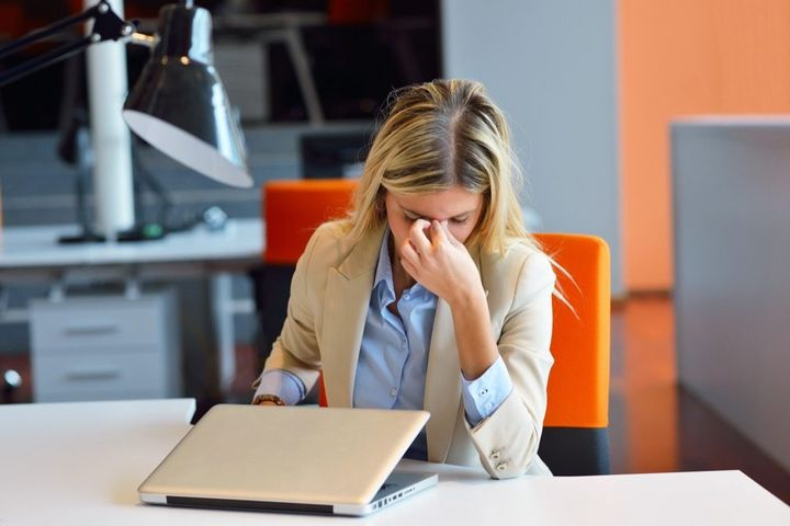 frustrated-woman-pinching-nose-in-office-1024x683.jpg