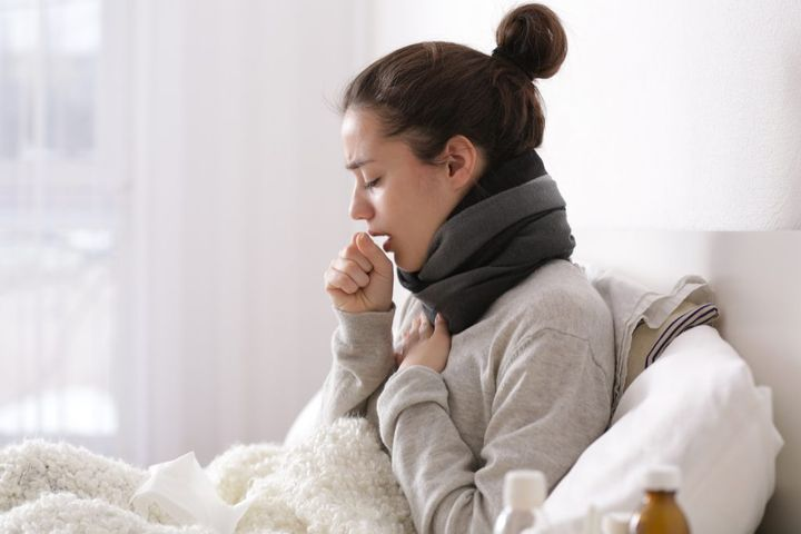 Woman-Coughing-in-Bed-1024x683.jpg