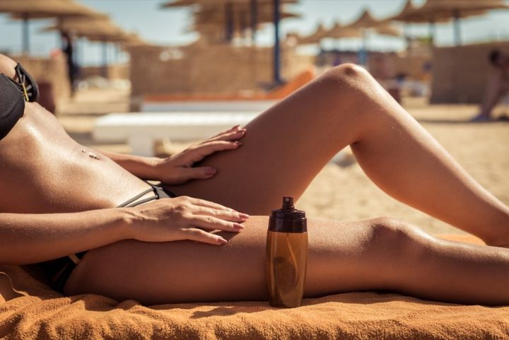 woman-with-tanning-lotion.jpg?resize=1024%2C684&ssl=1